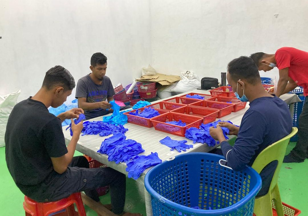 Gloves being prepared for packagingd
